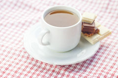 Chocolate and tea on plaid fabric Stock Photo