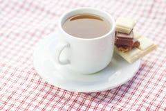 Chocolate and tea on plaid fabric Stock Photo