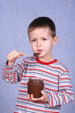 Chocolate temptation. Five years old boy with jar of chocolate - temptation Stock Image