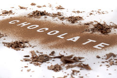 Chocolate text in chocolate powder stock images