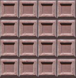 Chocolate texture repeating image background. Brown chocolate Stock Photo