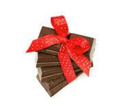 Chocolate tied with a red bow Stock Photography