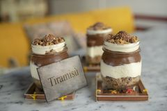 Chocolate Tiramisu with nuts in glass jar royalty free stock image