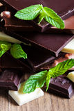 Chocolate tower with mint. Mix chocolate tower with fresh mint leaves Stock Photography