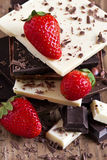 Chocolate tower with strawberry. Mix chocolate tower with ripe strawberry Stock Photo