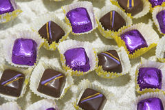 Chocolate Treats. Chocolates wrapped in purple foil or decorated royalty free stock photos