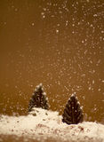 Chocolate trees with sugar snow. On brown background Stock Photo