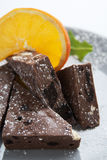 Chocolate triangles and orange slice Stock Photos