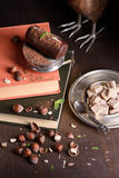Chocolate truffle cake with cocoa powder, hazelnuts and mint on rustic wooden table. Top view. Royalty Free Stock Images