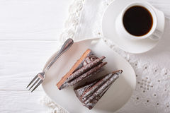 Chocolate truffle cake piece and coffee close-up on the table. H Royalty Free Stock Photography