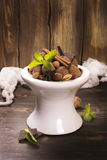 Chocolate truffle candies and assortment of nuts on white stand Stock Photo