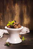 Chocolate truffle candies and assortment of nuts on white stand Stock Photography