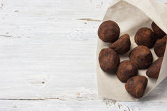 Chocolate truffle candies in the paper packing on the white back Royalty Free Stock Photo