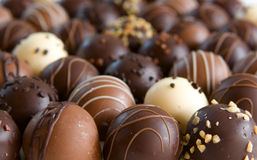 Chocolate truffle candy background. Focus only on front truffles Stock Images