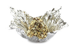 Chocolate truffle in candy wrapper. On the white background Royalty Free Stock Photography