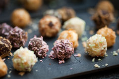 Chocolate truffle with colorful coatings. Home made chocolate confectionery with colorful coatings Stock Photo