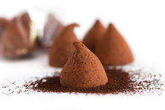 Chocolate truffle gift for the new year. Isolated on white background Royalty Free Stock Photo