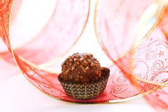 Chocolate truffle with red ribbon Royalty Free Stock Images