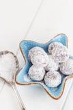 Chocolate truffle with sugar powder on white Royalty Free Stock Photos