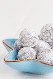 Chocolate truffle with sugar powder on white Royalty Free Stock Photo