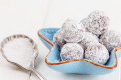 Chocolate truffle with sugar powder on white Royalty Free Stock Photography