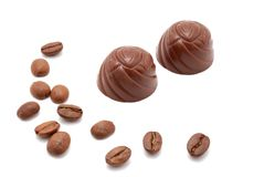 Chocolate truffles. Chocolate truffles, coffee beans. Isolated on white Royalty Free Stock Photos