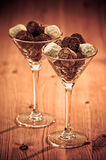 Chocolate Truffles. Luxury chocolate truffles in glasses on rustic wooden table royalty free stock photography