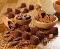 Chocolate truffles. On a brown table stock photography