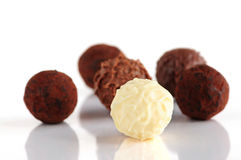 Chocolate truffles. Several assorted chocolate truffles isolated on white background stock image