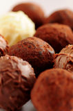Chocolate truffles. Several assorted gourmet chocolate truffles close up stock images