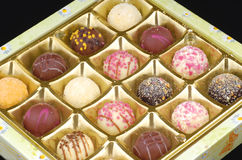 Chocolate truffles in a box Stock Photos