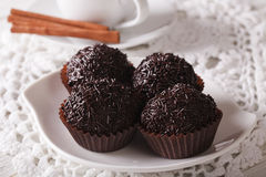 Chocolate truffles Brigadeiro on a plate close-up. horizontal Stock Photography