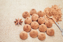 Chocolate truffles candies on a background of burlap bag texture Stock Image