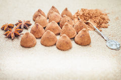 Chocolate truffles candies on a background of burlap bag texture Royalty Free Stock Photo