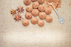 Chocolate truffles candies on a background of burlap bag texture Royalty Free Stock Photography