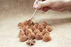 Chocolate truffles candies on a background of burlap bag texture Stock Photography