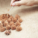 Chocolate truffles candies on a background of burlap bag texture Royalty Free Stock Photos