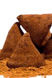 Chocolate truffles. Chocolate candies - truffles with cocoa powder on a white background Stock Photo