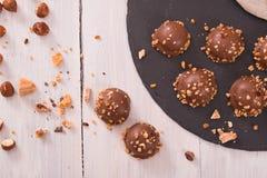 Chocolate truffles. Chocolate truffles with caramel cream filling stock photo