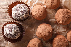 Chocolate truffles close-up in a rustic style. horizontal top vi. Chocolate truffles close-up on a wooden table in a rustic style. horizontal view from above royalty free stock photography