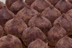 Chocolate truffles closeup horizontal. Selective focus background Royalty Free Stock Photos