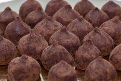 Chocolate truffles closeup horizontal. Selective focus background Stock Image