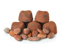 Chocolate truffles and cocoa beans Stock Photos