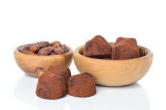 Chocolate truffles and cocoa beans Stock Photo