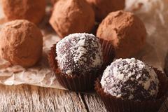 Chocolate truffles in cocoa and nuts macro on a table. horizonta Stock Images