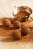 Chocolate truffles cocoa powder dusted and sieve. Shallow dof Royalty Free Stock Images