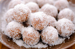 Chocolate truffles. Chocolate coconut truffles- Indian laddoo confectionary with a dash of orange rind royalty free stock photo