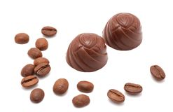 Chocolate truffles, coffee beans. Isolated on white Stock Images