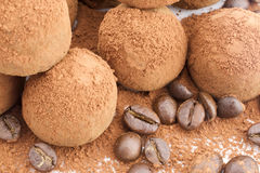 Chocolate Truffles with coffee beans. Chocolate Truffles coated cocoa powder on white background Stock Images
