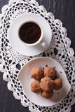 Chocolate truffles and coffee close-up on the table. vertical to Royalty Free Stock Photos